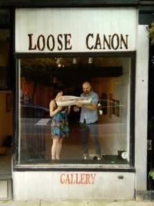 Jaqui and Jamie hanging the signage for Zoo at Loose Canon Gallery.