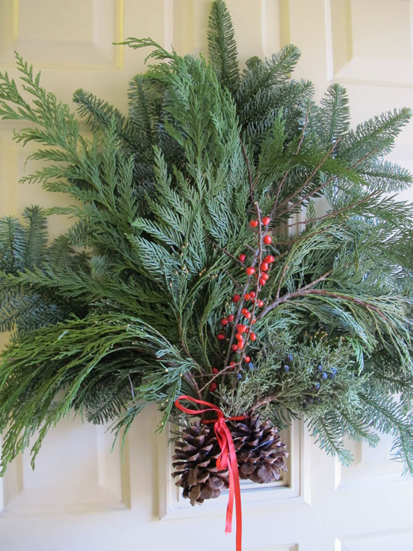 Christmas door decoration, wreath, cedar boughs, pine
