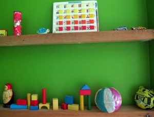 things on shelves green baby room
